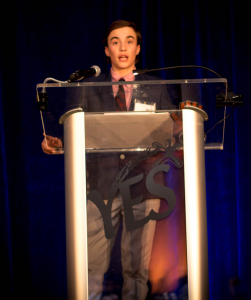Photo 1 YES youth and Brookline native Jordan Levitch speaking  at the YES Black Diamond Gala on April 2nd.